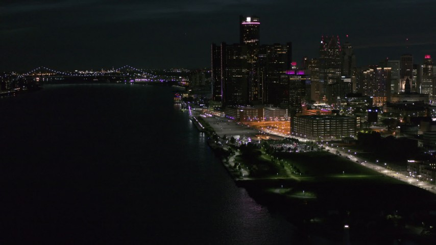 5.7K stock footage aerial video of orbiting GM Renaissance Center seen from river at night, Downtown Detroit, Michigan Aerial Stock Footage | DX0002_198_043
