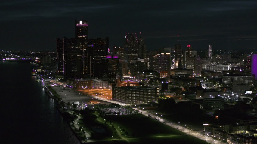 5.7K stock footage aerial video approach and flyby GM Renaissance Center and skyscrapers from river at night, Downtown Detroit, Michigan Aerial Stock Footage | DX0002_198_044