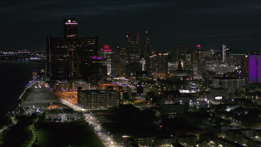 5.7K stock footage aerial video approach and flyby GM Renaissance Center and skyscrapers from river at night, Downtown Detroit, Michigan Aerial Stock Footage | DX0002_198_045