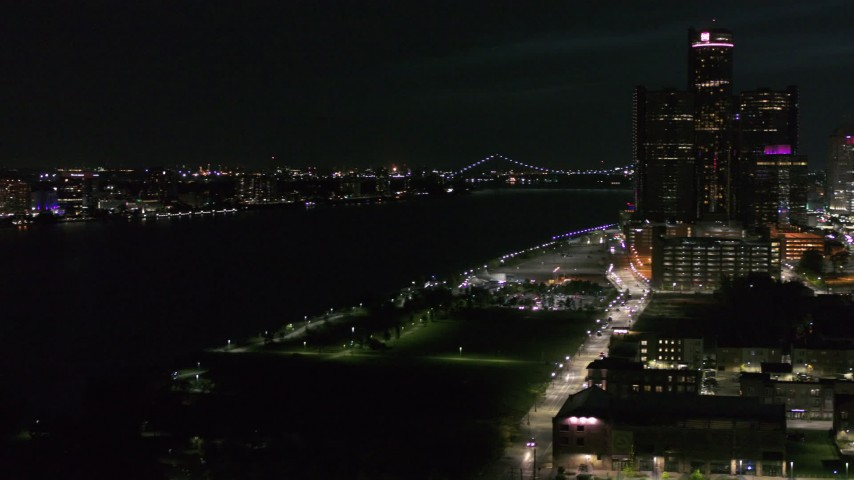 5.7K stock footage aerial video pan from the Downtown Detroit, Michigan skyline to reveal Windsor, Canada across the Detroit River Aerial Stock Footage | DX0002_198_046