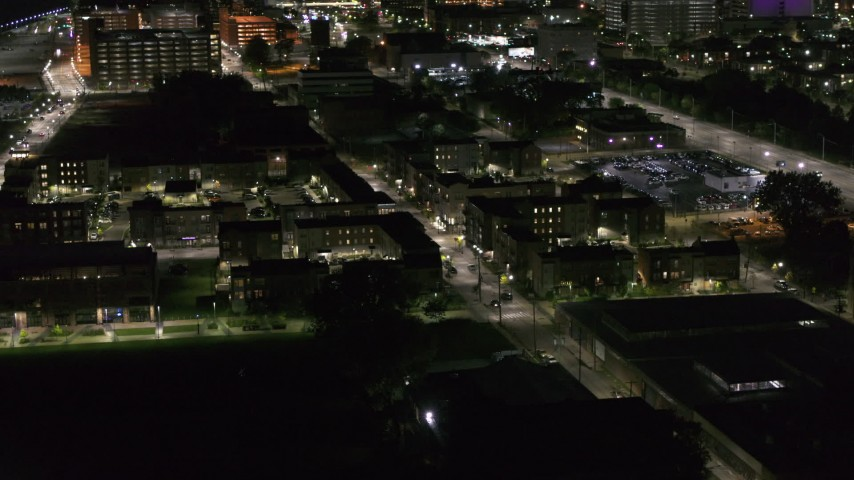 5.7K stock footage aerial video of orbiting an apartment complex at night, Downtown Detroit, Michigan Aerial Stock Footage | DX0002_198_051