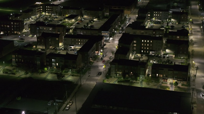 5.7K stock footage aerial video approach and orbit Franklin Street and an apartment complex at night, Downtown Detroit, Michigan Aerial Stock Footage | DX0002_198_052