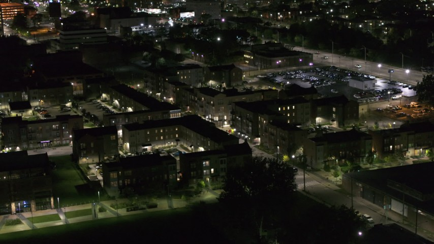 5.7K stock footage aerial video descend toward an apartment complex at night, Downtown Detroit, Michigan Aerial Stock Footage | DX0002_198_053