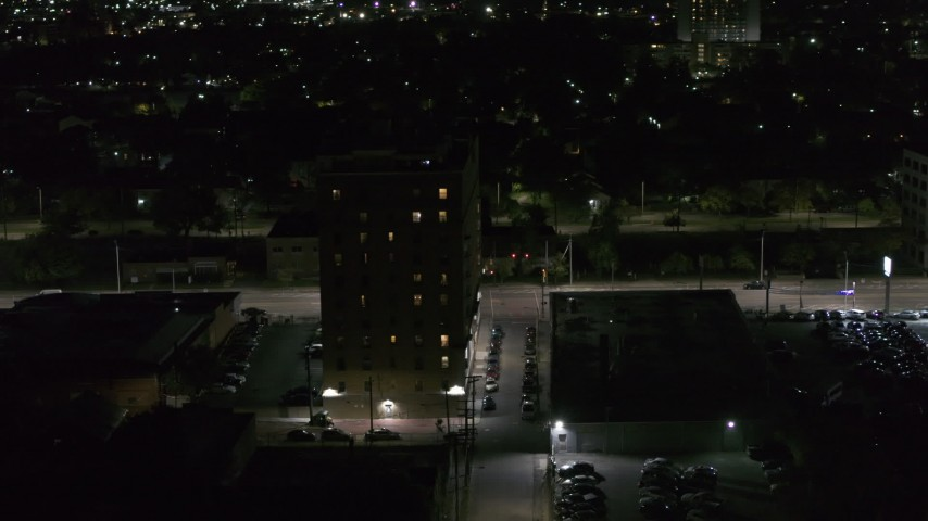 5.7K stock footage aerial video of an apartment building at night, Detroit, Michigan Aerial Stock Footage | DX0002_198_056