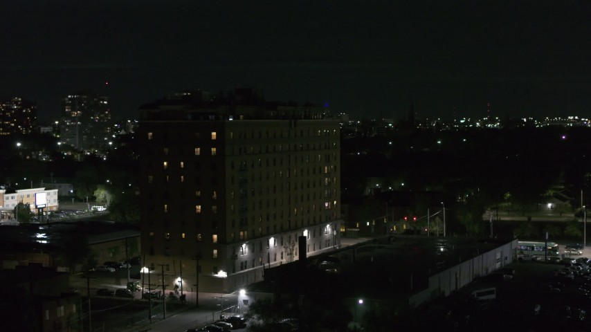 5.7K stock footage aerial video of an orbit of an apartment building at night, Detroit, Michigan Aerial Stock Footage | DX0002_198_059