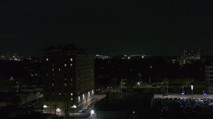 5.7K stock footage aerial video orbit an apartment building at nighttime, Detroit, Michigan Aerial Stock Footage | DX0002_198_060