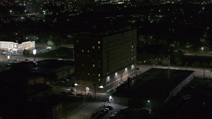 5.7K stock footage aerial video focus on an apartment building while ascending at night, Detroit, Michigan Aerial Stock Footage | DX0002_198_061