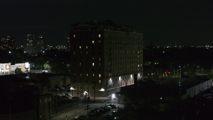 5.7K stock footage aerial video approaching Pasadena Apartments at nighttime, Detroit, Michigan Aerial Stock Footage | DX0002_198_063