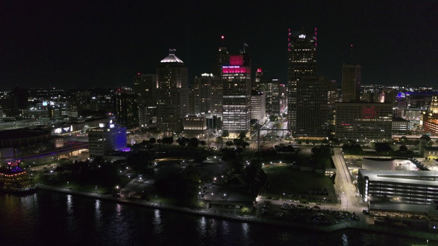 5.7K stock footage aerial video orbit towering skyscrapers and Hart Plaza at night, Downtown Detroit, Michigan Aerial Stock Footage | DX0002_199_008