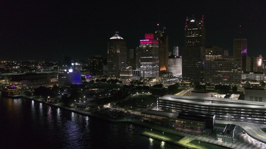 5.7K stock footage aerial video approach and orbit towering skyscrapers and Hart Plaza at night, Downtown Detroit, Michigan Aerial Stock Footage | DX0002_199_009