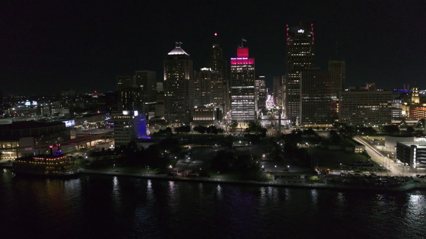 5.7K stock footage aerial video orbit Hart Plaza and towering skyscrapers at night, Downtown Detroit, Michigan Aerial Stock Footage | DX0002_199_010