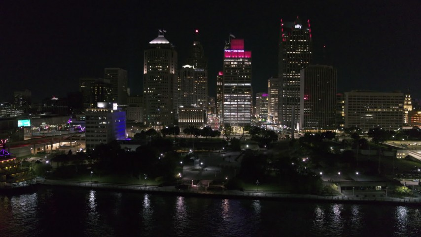 5.7K stock footage aerial video orbit and fly away from Hart Plaza and towering skyscrapers at night, Downtown Detroit, Michigan Aerial Stock Footage | DX0002_199_011