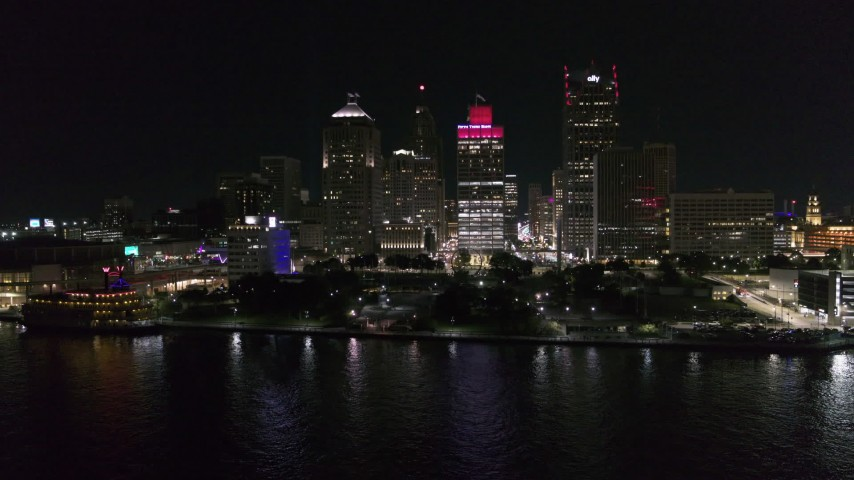5.7K stock footage aerial video stationary view of Hart Plaza and towering skyscrapers at night, Downtown Detroit, Michigan Aerial Stock Footage | DX0002_199_012