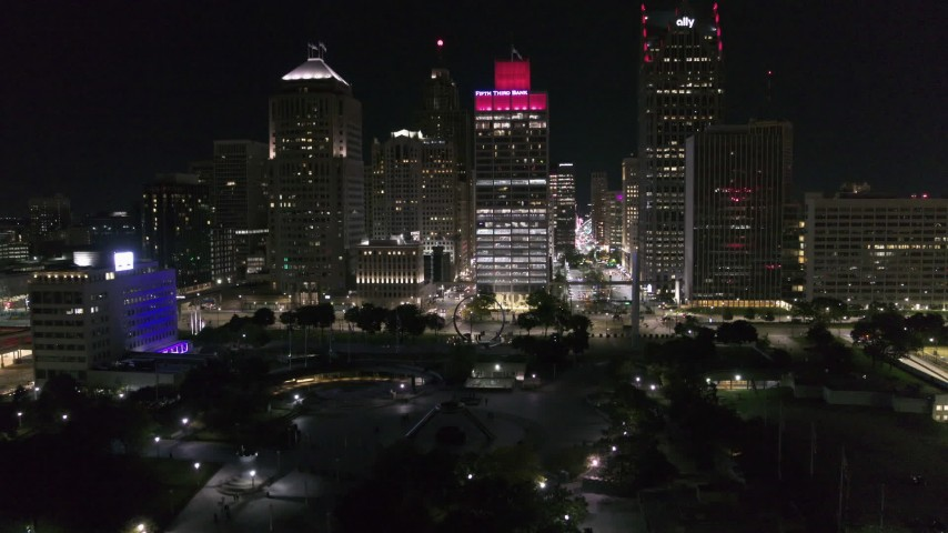 5.7K stock footage aerial video fly over river and Hart Plaza toward towering skyscrapers at night, Downtown Detroit, Michigan Aerial Stock Footage | DX0002_199_014
