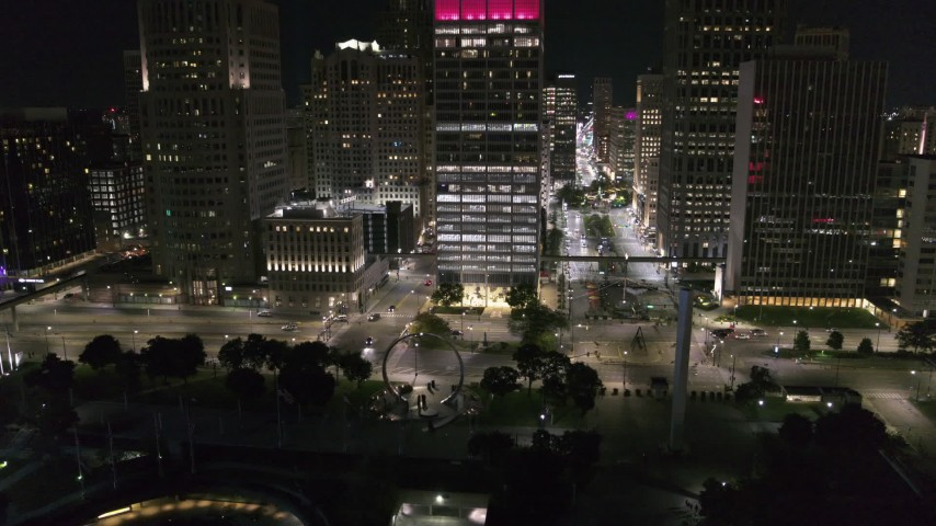 5.7K stock footage aerial video Jefferson Avenue seen while descending to Hart Plaza at night, Downtown Detroit, Michigan Aerial Stock Footage | DX0002_199_015