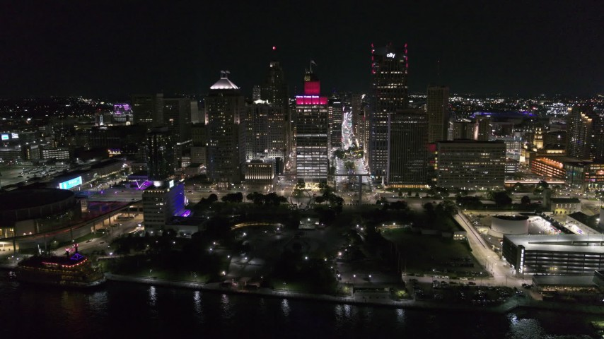 5.7K stock footage aerial video of an orbit of Hart Plaza and nearby skyscrapers at night, Downtown Detroit, Michigan Aerial Stock Footage | DX0002_199_017