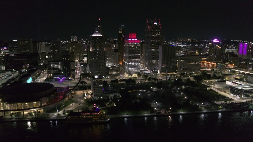 5.7K stock footage aerial video orbit Hart Plaza and nearby skyscrapers at night, seen from the river, Downtown Detroit, Michigan Aerial Stock Footage | DX0002_199_018