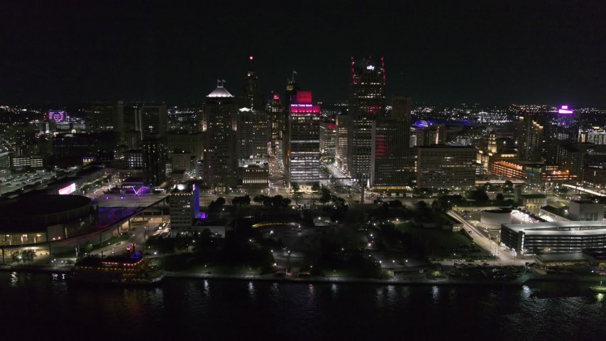 5.7K stock footage aerial video of circling Hart Plaza and skyscrapers at night, seen from the river, Downtown Detroit, Michigan Aerial Stock Footage | DX0002_199_020