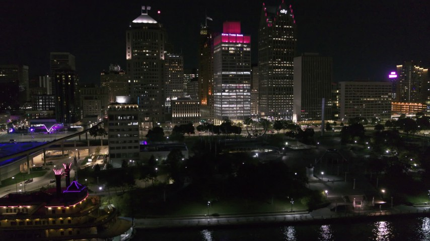 5.7K stock footage aerial video orbit riverfront Hart Plaza, focus on tall skyscrapers at night, Downtown Detroit, Michigan Aerial Stock Footage | DX0002_199_024