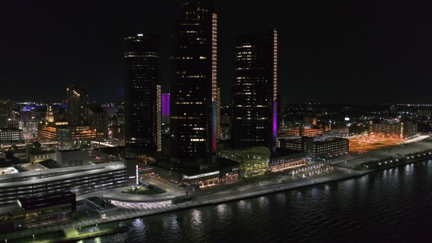 5.7K stock footage aerial video of orbiting GM Renaissance Center by the river at night, Downtown Detroit, Michigan Aerial Stock Footage | DX0002_199_027