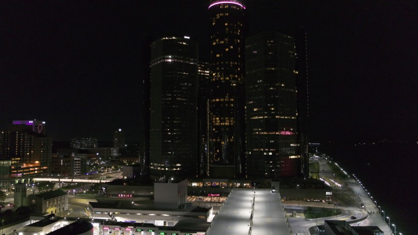 5.7K stock footage aerial video focus on GM Renaissance Center during descent at night, Downtown Detroit, Michigan Aerial Stock Footage | DX0002_199_030