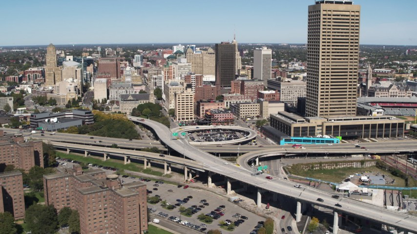 5.7K stock footage aerial video of I-190 by city buildings and Seneca One Tower, Downtown Buffalo, New York Aerial Stock Footage | DX0002_200_004