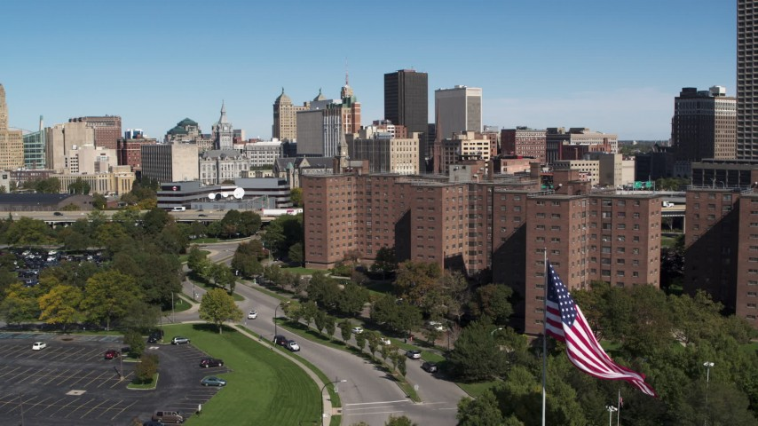 5.7K stock footage aerial video descend by apartment buildings with view of skyline, Downtown Buffalo, New York Aerial Stock Footage | DX0002_200_006