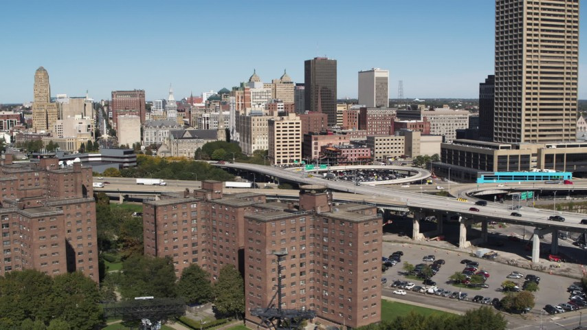 5.7K stock footage aerial video flyby apartment buildings and skyline, reveal I-190, Downtown Buffalo, New York Aerial Stock Footage | DX0002_200_007