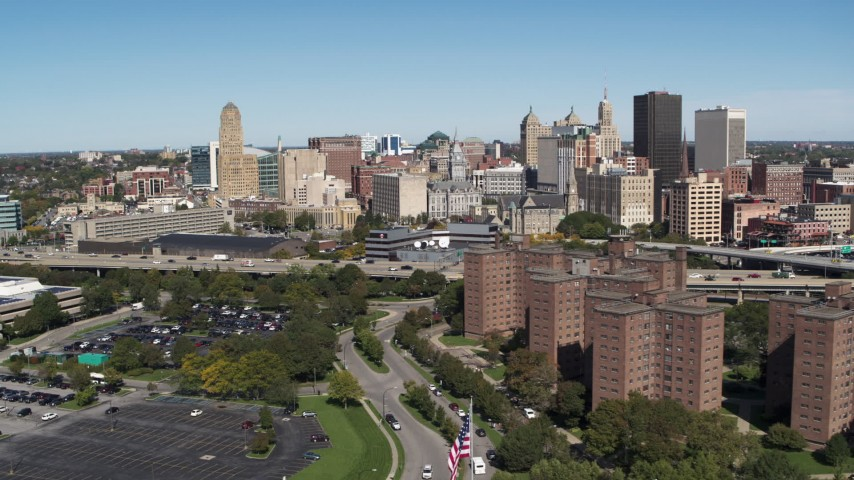 5.7K stock footage aerial video of a reverse view of the city's skyline and apartment buildings, Downtown Buffalo, New York Aerial Stock Footage | DX0002_200_011