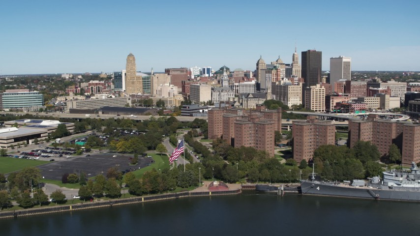5.7K stock footage aerial video of the city's skyline and apartment buildings seen from the river, Downtown Buffalo, New York Aerial Stock Footage | DX0002_200_012