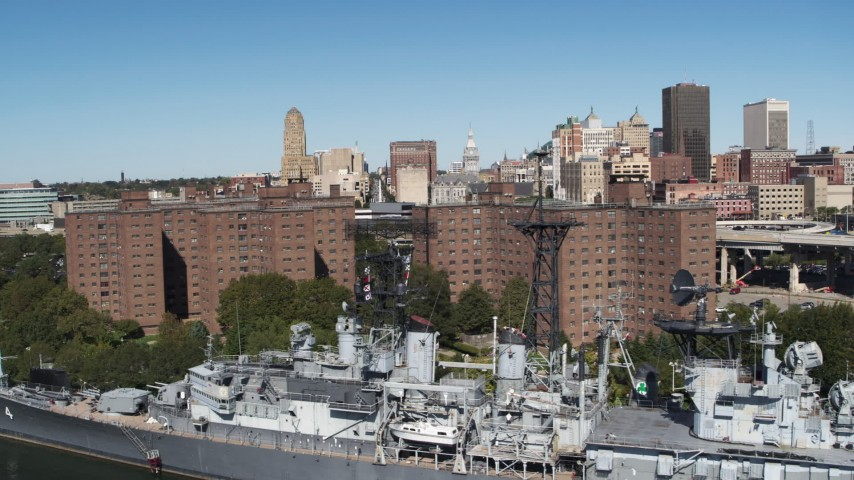 5.7K stock footage aerial video of the skyline while descending past apartment buildings, Downtown Buffalo, New York Aerial Stock Footage | DX0002_200_014