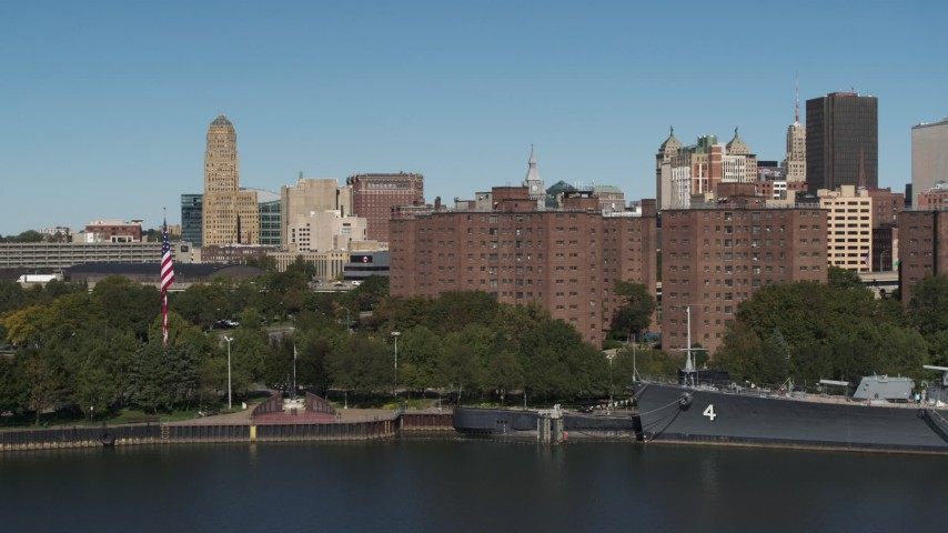 5.7K stock footage aerial video descend by river near Marine Drive Apartments, Downtown Buffalo, New York Aerial Stock Footage | DX0002_201_007