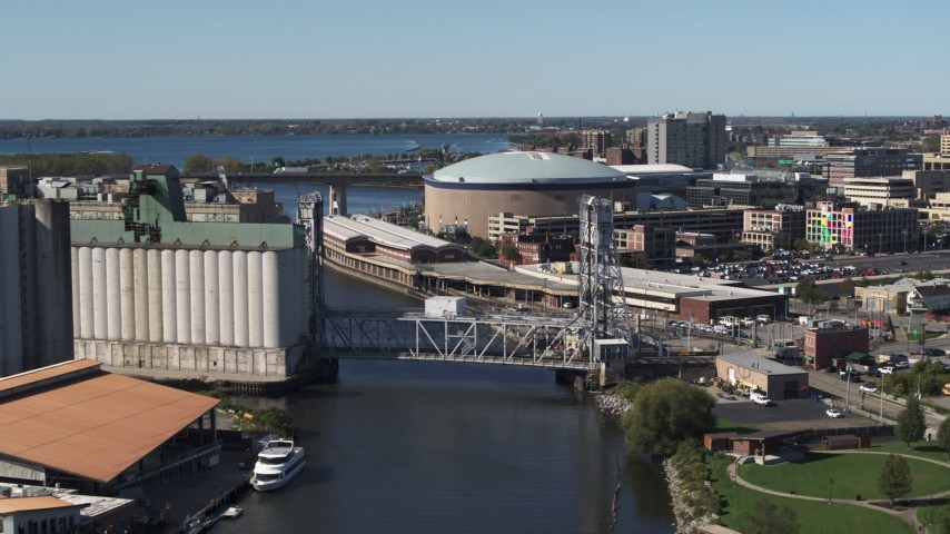 5.7K stock footage aerial video KeyBank Center arena by the river, Downtown Buffalo, New York Aerial Stock Footage | DX0002_201_015