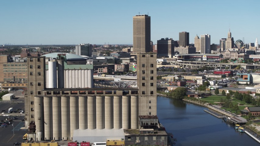 5.7K stock footage aerial video ascend and orbit a grain elevator in Buffalo, New York Aerial Stock Footage | DX0002_201_021