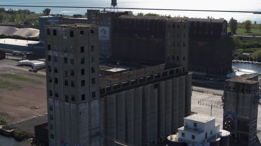 5.7K stock footage aerial video circling a large grain elevator in Buffalo, New York Aerial Stock Footage | DX0002_201_023