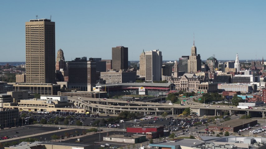 5.7K stock footage aerial video a view of the city's skyline behind Sahlen Field baseball stadium, Downtown Buffalo, New York Aerial Stock Footage | DX0002_201_027