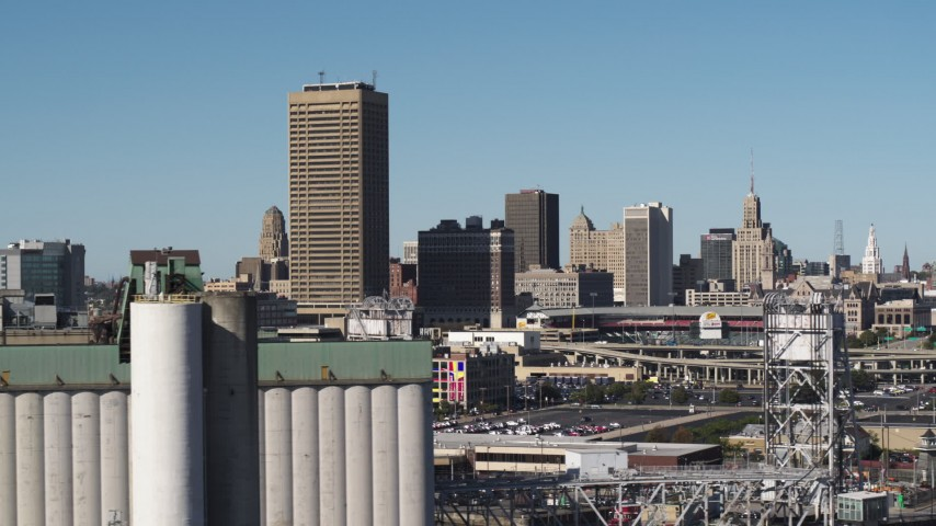 5.7K stock footage aerial video of the city's skyline and baseball stadium, seen from grain elevators, Downtown Buffalo, New York Aerial Stock Footage | DX0002_201_033