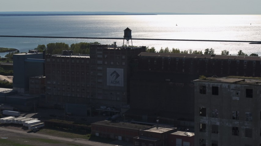 5.7K stock footage aerial video of orbiting a water tower on a flour mill in Buffalo, New York Aerial Stock Footage | DX0002_201_037
