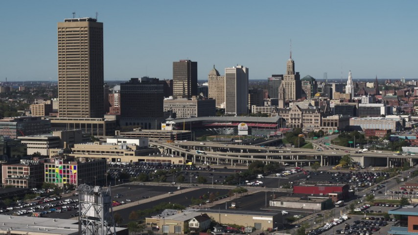 5.7K stock footage aerial video ascend for view of the baseball stadium and skyline in Downtown Buffalo, New York Aerial Stock Footage | DX0002_201_041