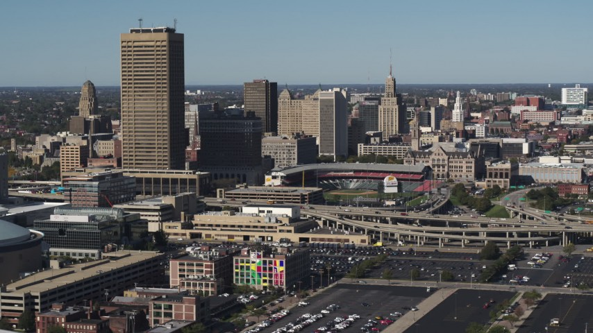 5.7K stock footage aerial video slowly passing the baseball stadium and skyline in Downtown Buffalo, New York Aerial Stock Footage | DX0002_201_044