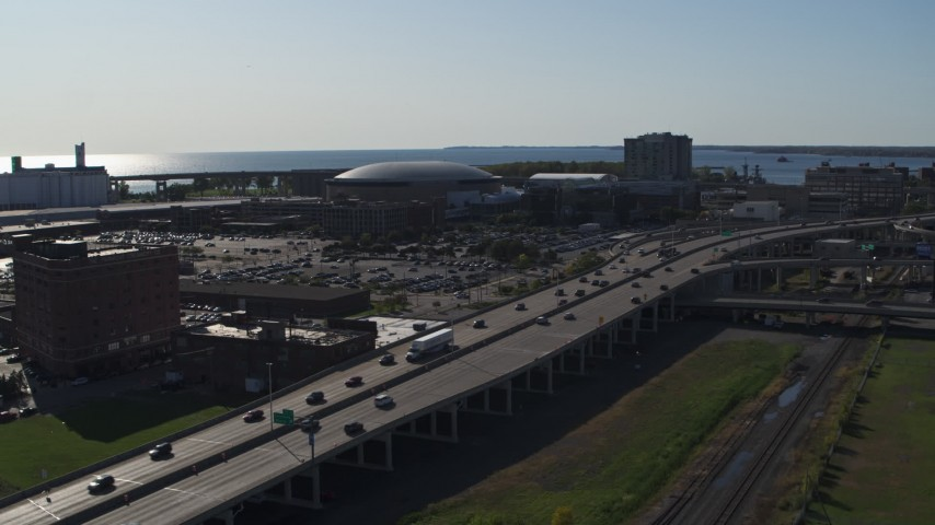 5.7K stock footage aerial video focus on KeyBank Center arena and descend by freeway, Downtown Buffalo, New York Aerial Stock Footage | DX0002_202_024