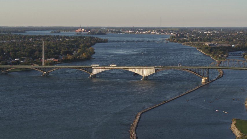 5.7K stock footage aerial video of traffic crossing the Peace Bridge in Buffalo, New York Aerial Stock Footage | DX0002_203_028