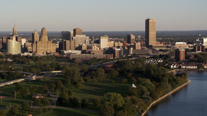 5.7K stock footage aerial video of the city's skyline at sunset, seen from La Salle Park, Downtown Buffalo, New York Aerial Stock Footage | DX0002_203_034