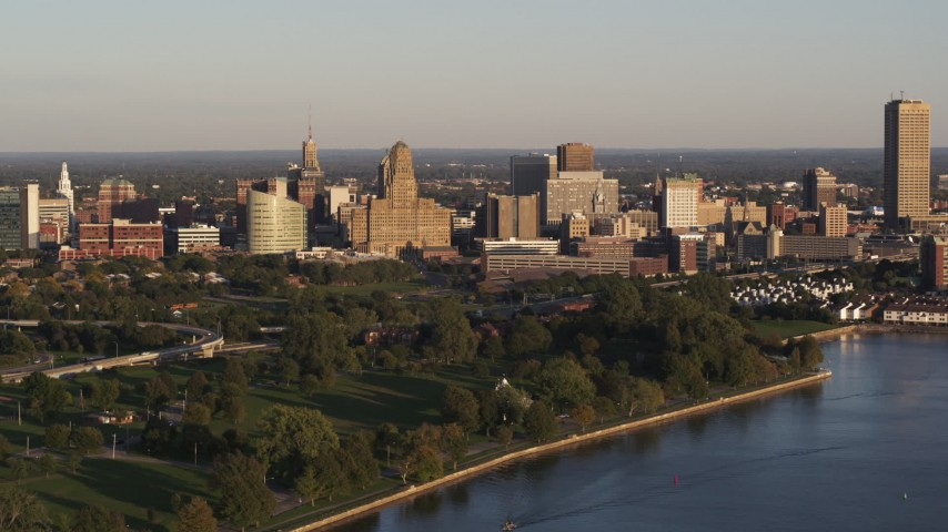 5.7K stock footage aerial video of the downtown skyline seen from the lake at sunset, Downtown Buffalo, New York Aerial Stock Footage | DX0002_203_039