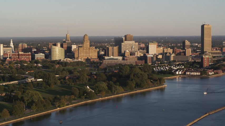 5.7K stock footage aerial video of the downtown skyline seen from the lakeside park at sunset, Downtown Buffalo, New York Aerial Stock Footage | DX0002_203_040