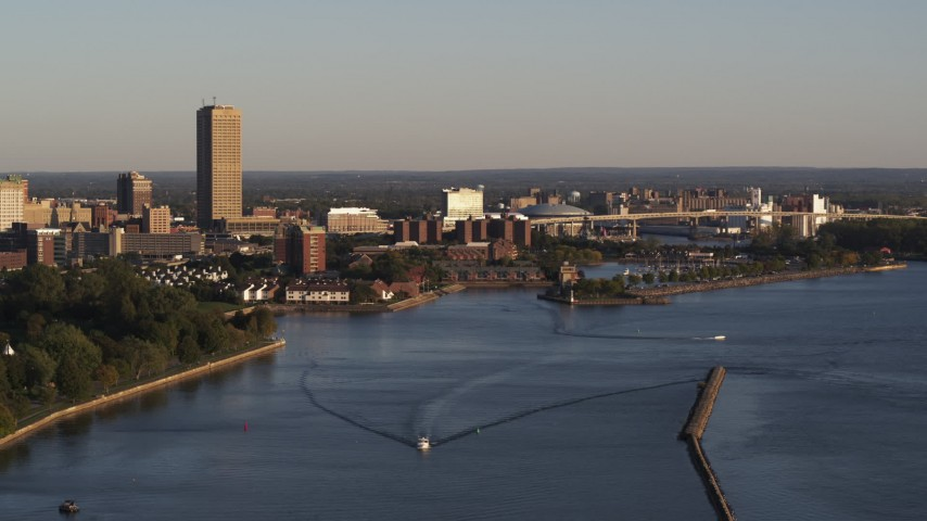 5.7K stock footage aerial video of Seneca One Tower and Buffalo River at sunset, Downtown Buffalo, New York Aerial Stock Footage | DX0002_203_041
