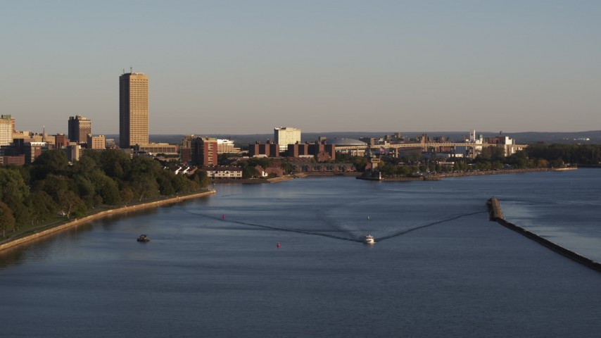 5.7K stock footage aerial video of Seneca One Tower near the Buffalo River at sunset, Downtown Buffalo, New York Aerial Stock Footage | DX0002_203_042