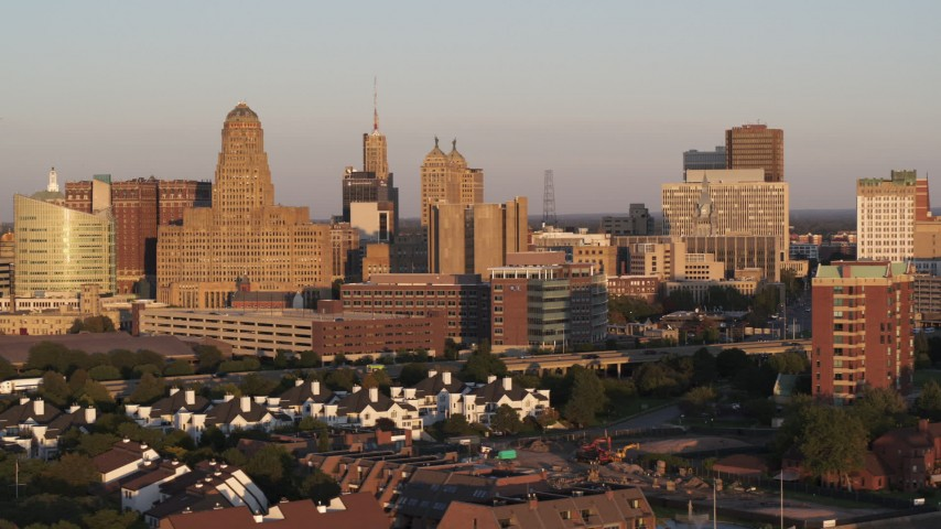 5.7K stock footage aerial video of city hall beside the Buffalo City Court at sunset, Downtown Buffalo, New York Aerial Stock Footage   DX0002_204_001