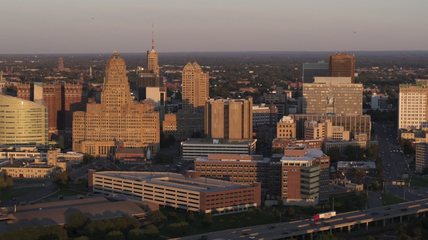 5.7K stock footage aerial video of a view of city hall beside courthouse and office buildings at sunset, Downtown Buffalo, New York Aerial Stock Footage | DX0002_204_003