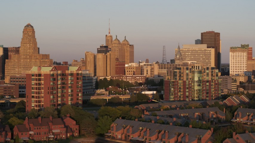 5.7K stock footage aerial video of city hall, courthouse and office buildings seen from condos at sunset, Downtown Buffalo, New York Aerial Stock Footage | DX0002_204_004